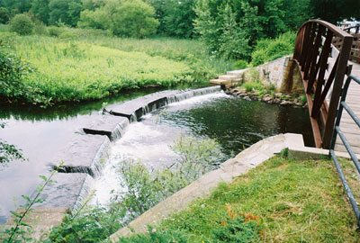 The Woonasquatucket River & Arching Footbridge at Esmond Park - Photo by Richard Mello (2004)