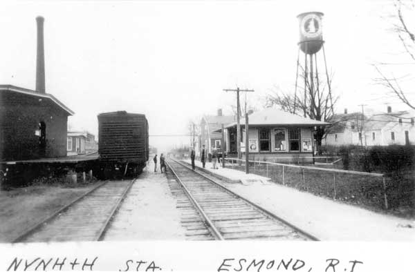 Esmond Train Station - Maple Ave. (off Esmond St.). Note the Esmond Bunny logo on the water tower on the top right of the picture. The bunny was the logo for the famous Esmond Bunny Baby Blanket produced at the Esmond Mills.